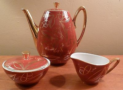 Vintage mid-century modern maroon and gold tea or coffee pot, sugar, creamer