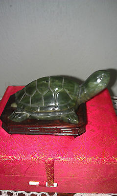 A carved green jade turtle with base
