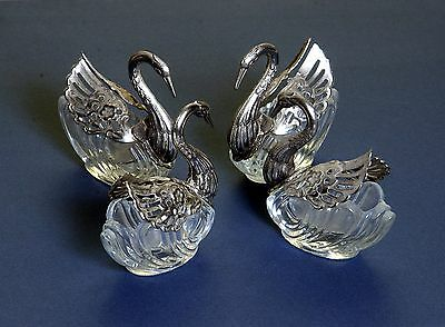 FOUR MATCHING VINTAGE SILVER PLATE AND GLASS SWAN FORM SALT CELLARS