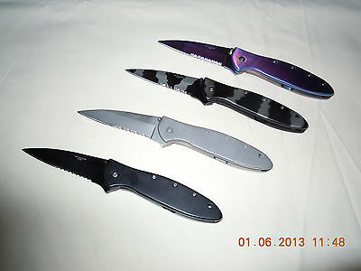 A WHOLESALE LOT OF 4 ASSISTED OPEN KNIVES...ALL NEW IN BOX