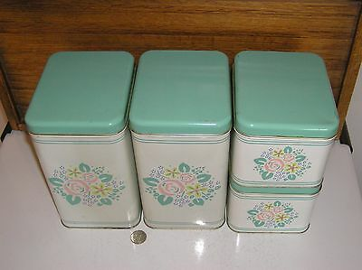 vintage metal 4 CANISTER set turquoise aqua blue with flowers
