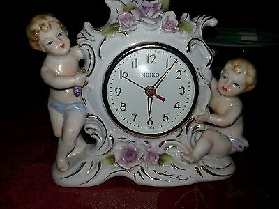 Antique  mantel clock with cherubs