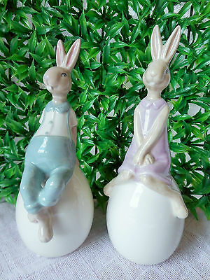 Set Of 2 Very Cute Porcelain  Rabbits  Sitting On Easter Eggs