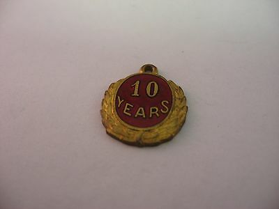 Great 10 Year Antique Vintage Red Enamel Gold Tone Charm Pendant
