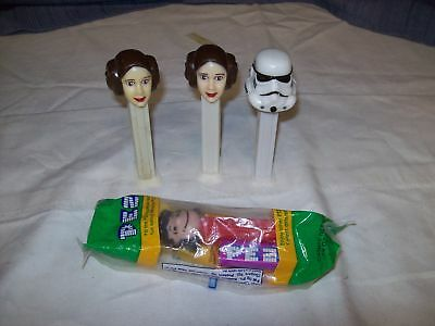Lot of 4 Pez Candy dispensers 3 StarWars1 Charley Brown
