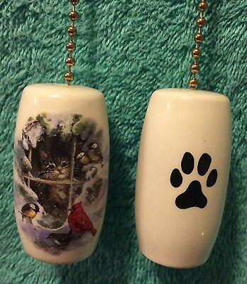 """One Cat Looking At The Birds Fan Pull With A Paw Print On The Back 2"""""""