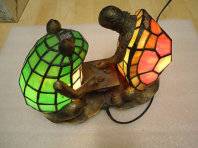 Collectible frog and turtle lamp playing chess red and green light.