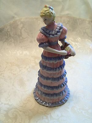 """Ceramic Girl Bell in a Blue and Pink Dress Holding a Basket of Flowers 6"""" Tall"""
