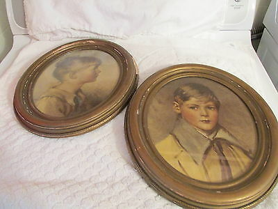"""PAIR OF GOLD PLASTER OVER WOOD FRAMES WITH BOY AND GIRL PIC SIZE IS 8"""" BY 10"""""""
