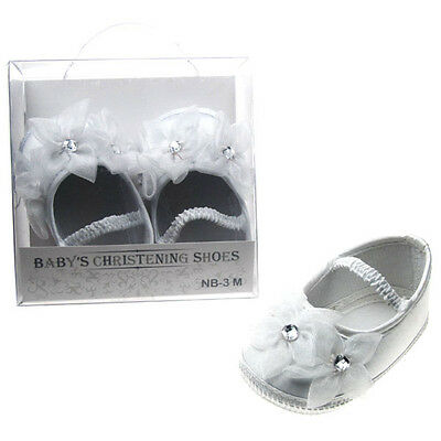 Baby Girl White Satin Christening shoe with 3 floral and round diamante detail.