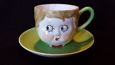 Nippon Character Handpainted Tea Cup and Saucer