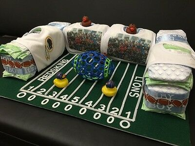Diaper cake (custom teem players football ground cake)