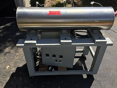 Used Marshall brand1000F tube oven with frame