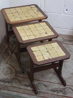 A SET of G PLAN MAHOGANY RETRO / VINTAGE TILE TOPPED NEST OF 3 TABLES.