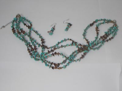 Beautiful 5 strand simulated turquoise, stone and gold beads necklace earrings.