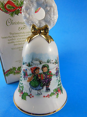 AVON 1986 Porcelain Christmas Bell Children ice skating Winter scene
