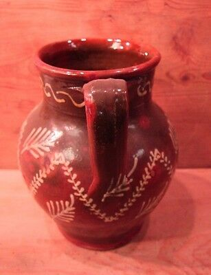 Spanish redware two handled jug with slip decoration