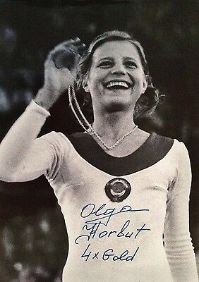 OLGA KORBUT SIGNED & INSCRIBED 12x15 PHOTO- CAPTURING GOLD AT THE 1972 OLYMPICS