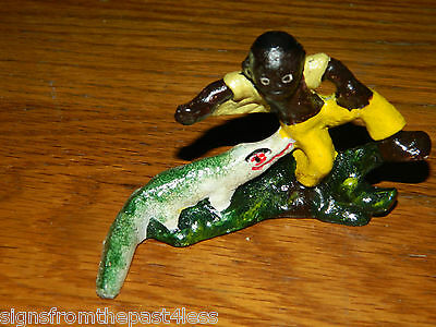 Black Americana Cast Iron Paper Weight Boy W/ Alligator Pinching Pants
