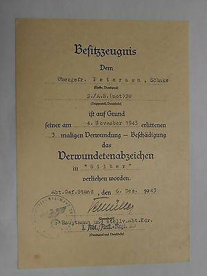 German, WWII Document for Wounded Badge in Silver (Sonke Petersen 1943.)