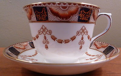 Vintage Colclough 4995 cup and saucer with rust and cobalt border, rust garland