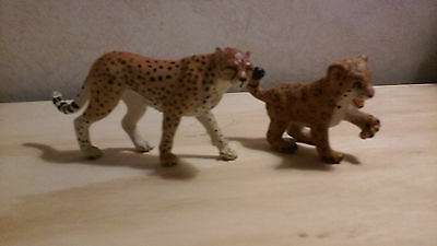 cheetah and leopard figurines