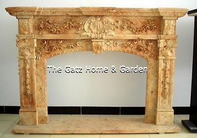 Beautiful Marble Fireplace Mantel features Flowers and Swags Throughout