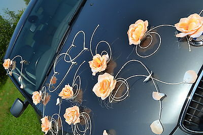 wedding car decoration, ribbon, bows, prom limousine peach orange petals