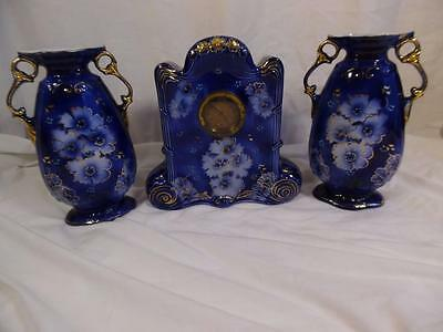 Victorian Porcelain working Clock Garniture blue with floral guilt decoration