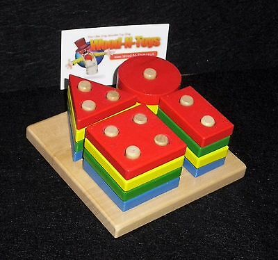 Shape sorter, square, triangle, circle and rectangle. Wooden toy