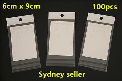 100 White Display Cards 6x9cm Earring Pendant Chain Jewellery + 100p 7x10cm Bags