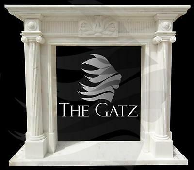 Elegantly Carved Marble Fireplace Mantel features Double Fluted Ionic Columns
