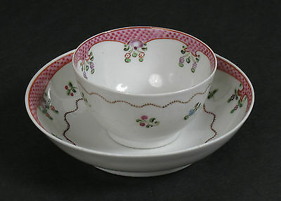 An 18th Century New Hall style English porcelain tea cup and saucer