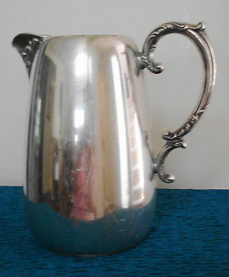 Antique Wm. Rogers silver water pitcher Silver Iris hollowware