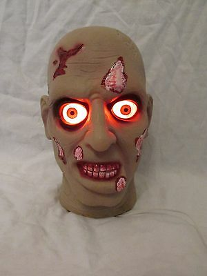 Creepy Halloween Prop Zombie Head Porch/Table Lighted (Eyes Light Up Red)