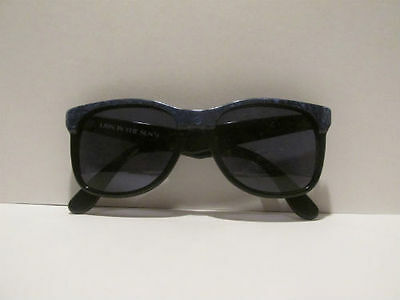 2a0f585662e Lion In The Sun Sunglasses Black and Blue Frame with Sola UV Guard Lenses