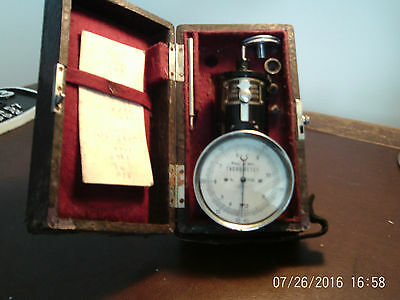 vintage tachometer in original case with instructions