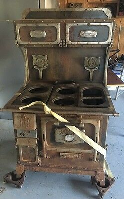 Monarch Cast Iron Wood Burning Antique Stove Complete
