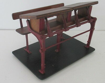 antique scaled model of a school desk row