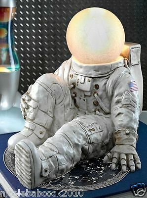 astronaut illuminated by a globe symbolizing the moon collectible lighted sculpt