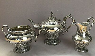 Victorian silver three piece tea set with repousse scrolled decoration 1838
