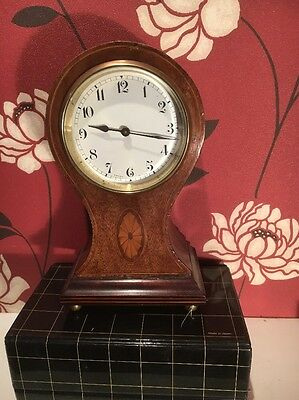 "BALLOON CLOCK IN A  MAHOGANY CASE 8 1/2 "" HIGH  in good working order."
