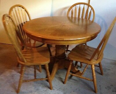 "Oak Pedestal Table with solid Arrow-back Chairs; Top 52"" /107 cm diameter"