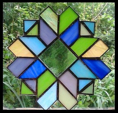 STAINED GLASS PANEL. Handmade by The Stained Glass Panel Studio.