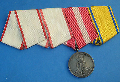 4 ribbons with Danish army faithfull service silver medal