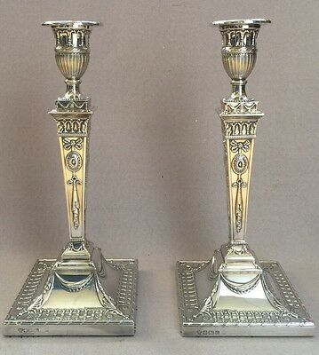 A pair of 19th century style silver candlesticks hallmarked Sheffield 1989