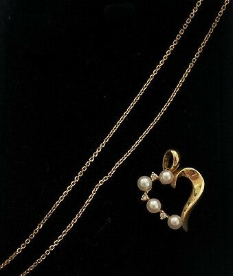 14ct solid gold heart pendant with diamonds pearls and 585 chain