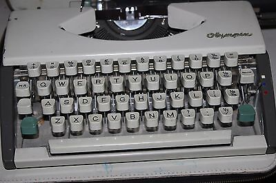 Vintage 1960's Olympia DeLuxe Portable Typewriter in Carry Case deluxe