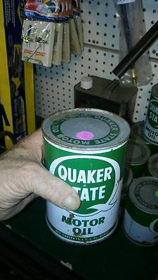 cans of Quaker state oil