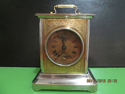 Antique travel alarm clock